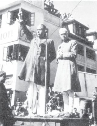 Pt. Nehru making his historic public address at Palladium, Lal Chowk, Srinagar. On his left is Sheikh Mohd. Abdullah, The Head of Emergency Administration.
